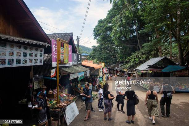 Stores line the street at the entrance to Kuang Si Waterfall in Luang Prabang Province Laos on Sunday Oct 21 2018 Laos's economy is set to expand at...