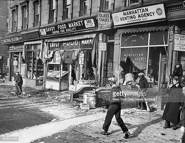 Stores on the corner of Lenox Avenue between 129th and 130th Sts after a night of rioting in Harlem