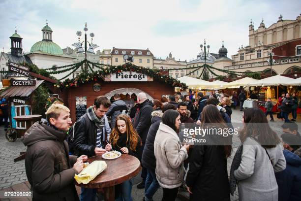 Stores with handicraft products and regional food at a traditional Christmas Market at the Main Square in Krakow Poland on November 25 2017