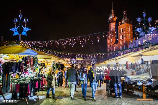 Stores with handicraft products at a traditional Christmas Market at the Main Square in Krakow Poland on November 25 2017