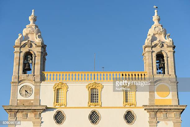 A stork sitting on the tower of the Carmo Church in Faro city center Faro Algarve Portugal on 28 November 2015