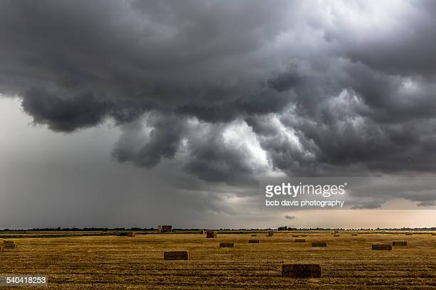 storm after harvest - storm cloud stock pictures, royalty-free photos & images