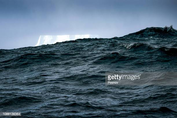 storm and iceberg - drake passage stock photos and pictures