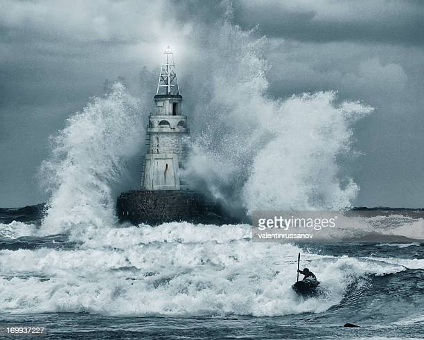 storm and lighthouse - gale stock photos and pictures
