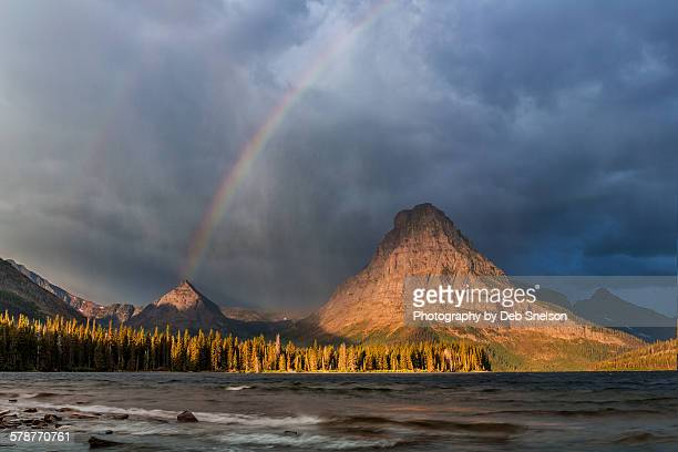 storm and rainbow over mt sinopah glacier np - two medicine lake montana stock-fotos und bilder