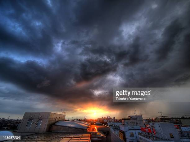 storm approaching suburban area of tokyo - suginami stock photos and pictures