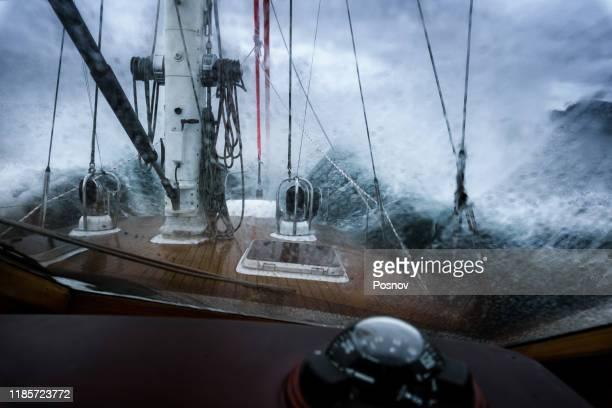 storm at greenland sea - sailboat stock-fotos und bilder