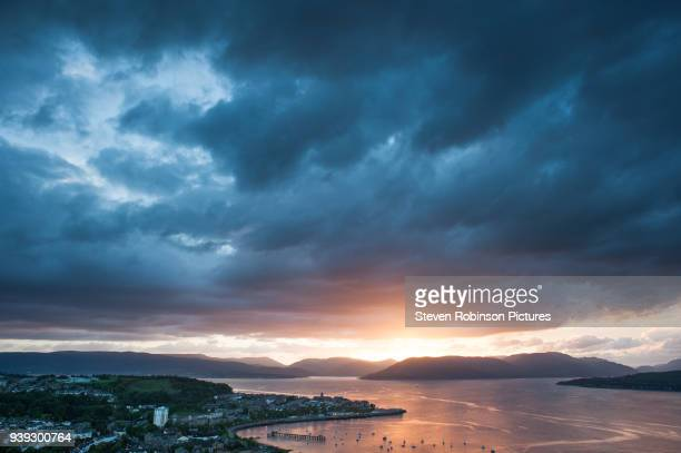 storm at sundown - dramatic sky stock pictures, royalty-free photos & images