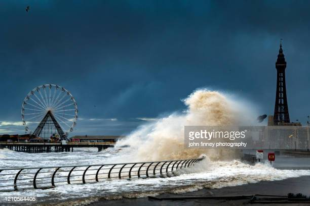 storm batters blackpool with massive waves - flood stock pictures, royalty-free photos & images