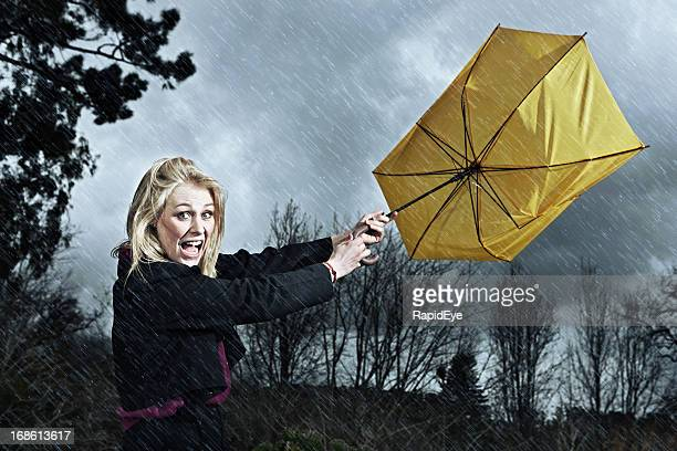 Storm blows woman's umbrella inside-out