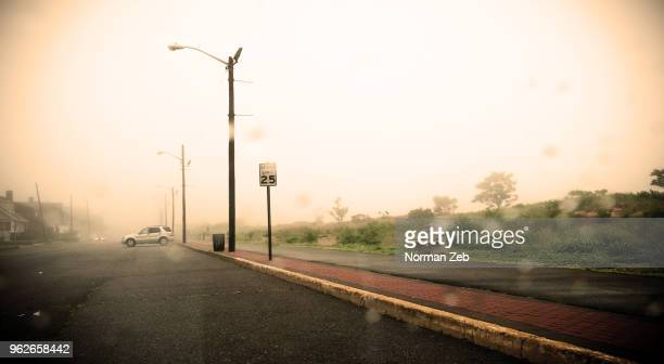 a storm brews (keansburg beach, nj) - dust storm stock pictures, royalty-free photos & images