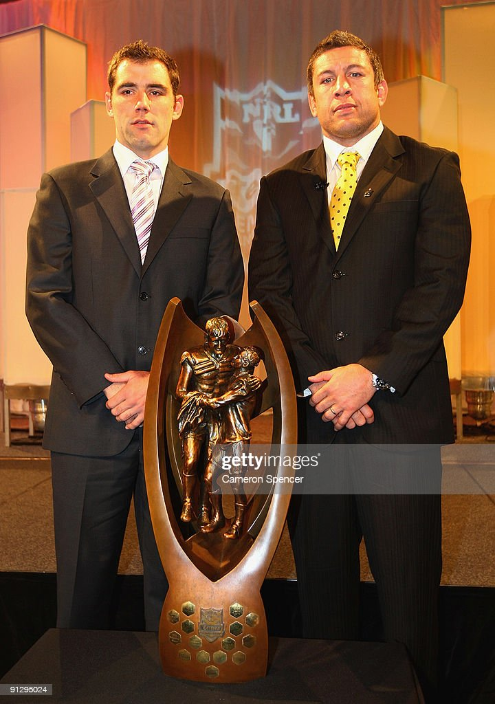 Storm captain Cameron Smith and Eels captain Nathan Cayless pose with the Telstra Premiership Trophy during the 2009 NRL Grand Final Breakfast at Sydney Convention & Exhibition Centre on October 1, 2009 in Sydney, Australia.