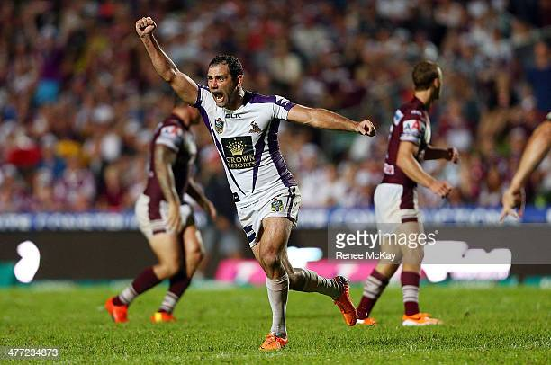 Storm captain Cameron Smith celebrates his winning drop goal in golden point time during the round one NRL match between the Manly Sea Eagles and the...