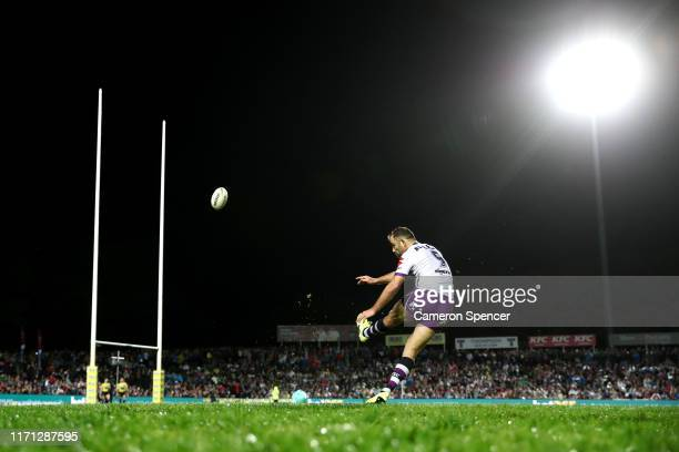 Storm captain Cameron Smith kicks for goal during the round 24 NRL match between the Manly Sea Eagles and the Melbourne Storm at Lottoland on August...