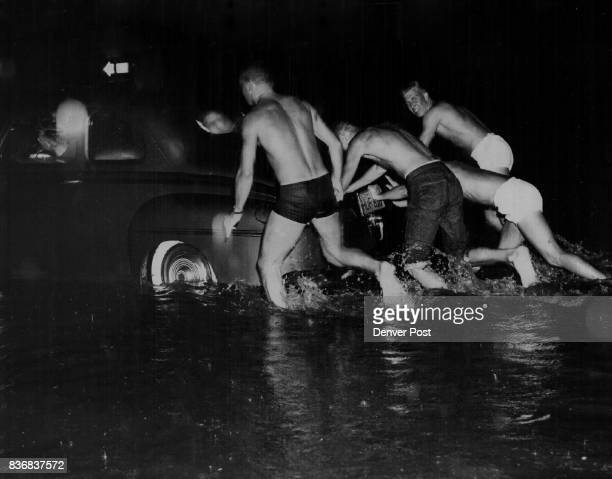 Storm catches lowry airmen ready for action A3/C William OWalls and his buddies were all prepared for the three feet of water in which their car...