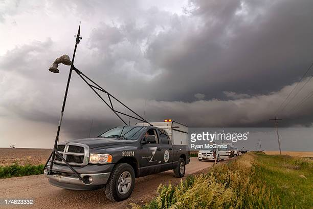 Storm chasing vehicles with the Center for Severe Weather Research watch and wait as a supercell thunderstorm approaches near Hays, Kansas, May 25,...