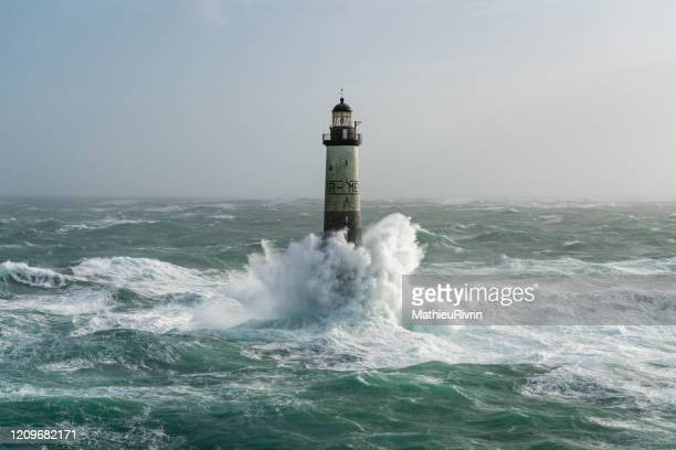 storm ciara in bretagne with huge waves - ar-men lighthouse - lighthouse stock pictures, royalty-free photos & images