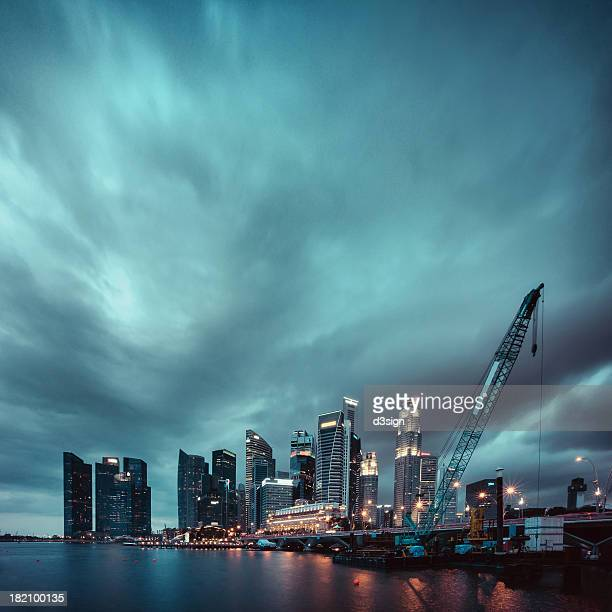 Storm cloud over commercial skyscrapers