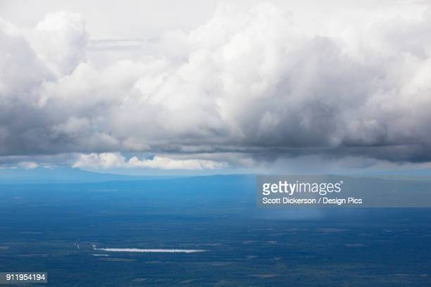 a storm cloud over the blue ocean water with rain falling, matanuska-susitna borough - mt. susitna stock pictures, royalty-free photos & images