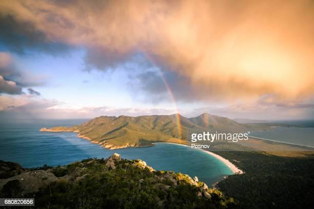 storm cloud passing by mt amos. view towards wineglass bay. freycinet peninsula, tasmania - tasmania stock pictures, royalty-free photos & images