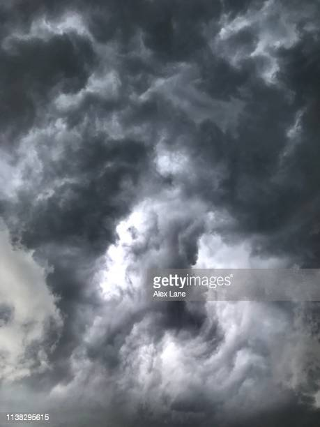 storm cloud swirl - storm cloud stock pictures, royalty-free photos & images