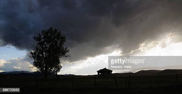 storm clouds above a house. - hope imagens e fotografias de stock