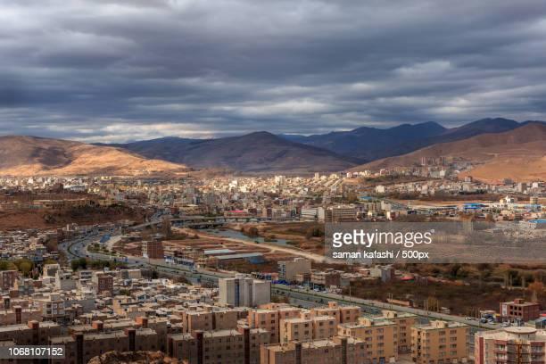 storm clouds above city, kurdistan, iran - クルディスタン ストックフォトと画像