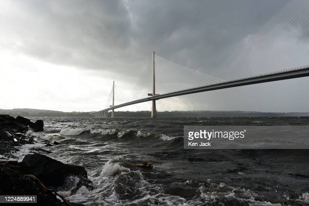Storm clouds above Queensferry Crossing on the Firth of Forth, as parts of Scotland are affected by heavy rain and strong winds, on July 5, 2020 in...