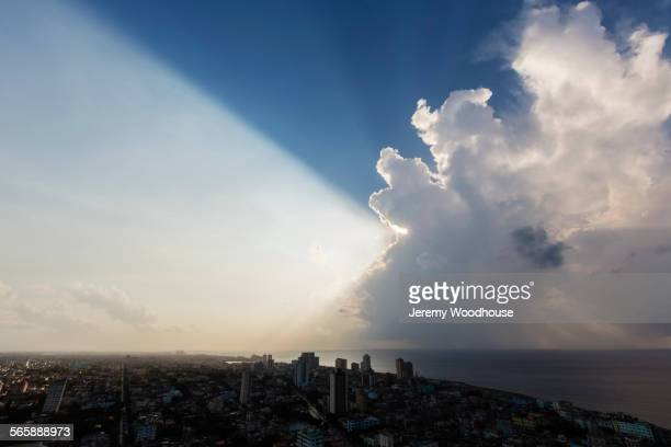 storm clouds and sunbeams over havana cityscape, havana, cuba -  565888973 stock pictures, royalty-free photos & images
