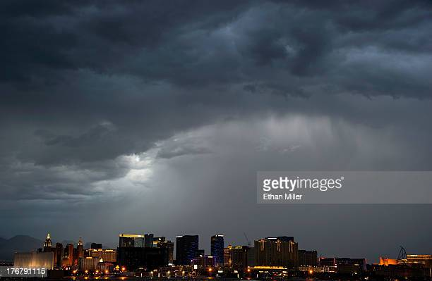 Storm clouds appear above the Las Vegas Strip on August 18 2013 in Las Vegas Nevada Thunderstorms swept across the area on Sunday prompting the...