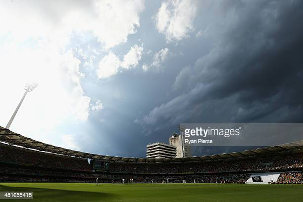 Storm clouds approach the ground during day four of the First Ashes Test match between Australia and England at The Gabba on November 24, 2013 in...