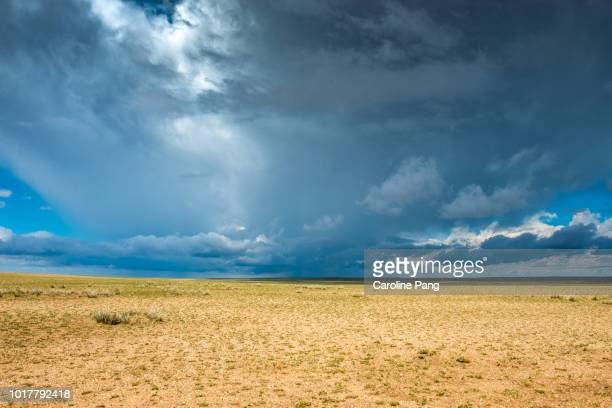 Storm clouds approaching the Gobi desert in the late summer afternoon.