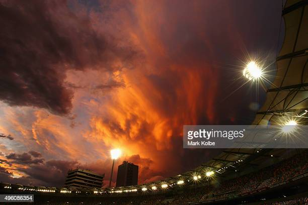 Storm clouds are seen as the sun sets after play on day three of the First Test match between Australia and New Zealand at The Gabba on November 7...