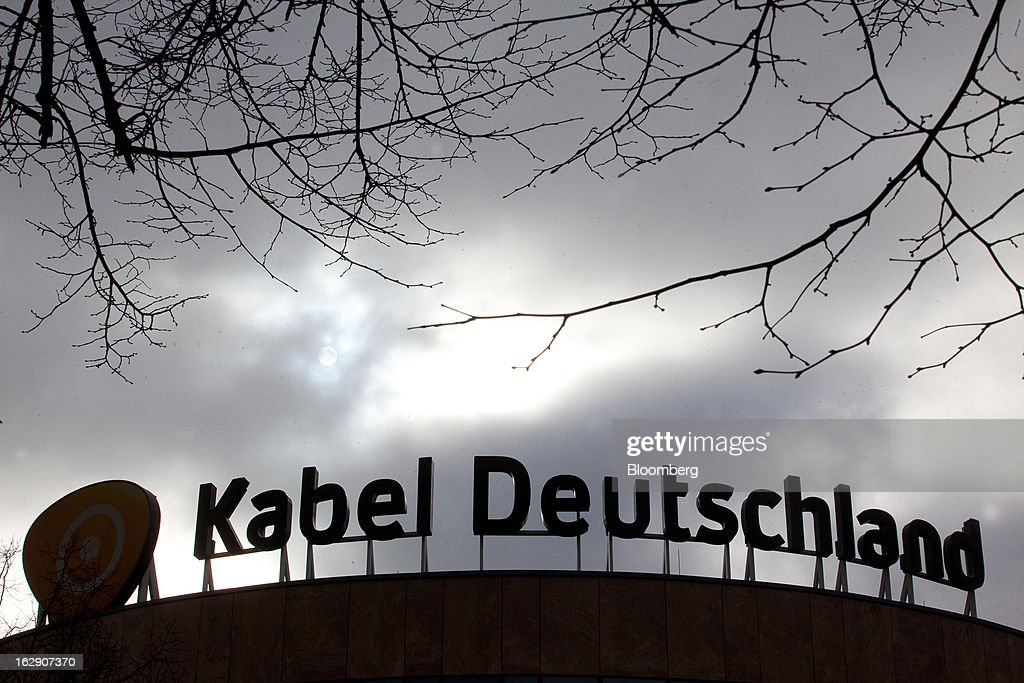 Storm clouds are seen gathering over the headquarters of Kabel Deutschland Holding AG, the German cable operator in Berlin, Germany, on Friday, March 1, 2013. Vodafone Group Plc has put on hold plans to approach Kabel Deutschland Holding AG about a takeover bid after leaks of a potential offer complicated internal discussions, according to three people familiar with the matter. Photographer: Krisztian Bocsi/Bloomberg via Getty Images