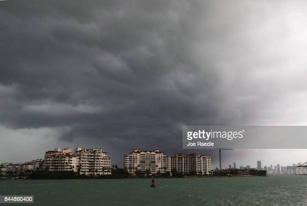 Storm clouds are seen over Fisher Island as Hurricane Irma approaches on September 9 2017 in Miami Beach Florida Florida is in the path of the...