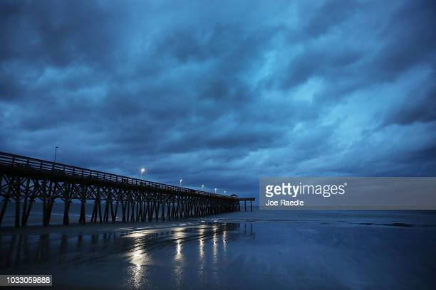 Storm clouds are seen over the 2nd ave pier as the force of Hurricane Florence is beginning to be felt on September 14 2018 in Myrtle Beach United...