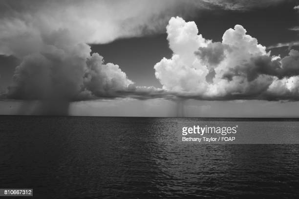 storm clouds at mt. myers beach - bethany beach stock photos and pictures