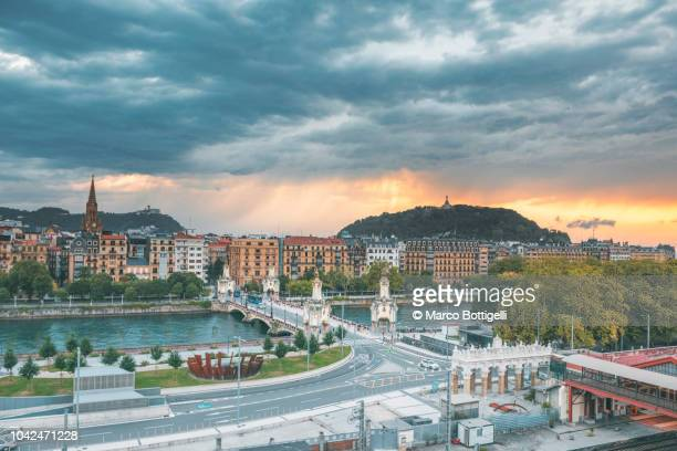 storm clouds at sunset over san sebastian, spain - san sebastian spain stock pictures, royalty-free photos & images