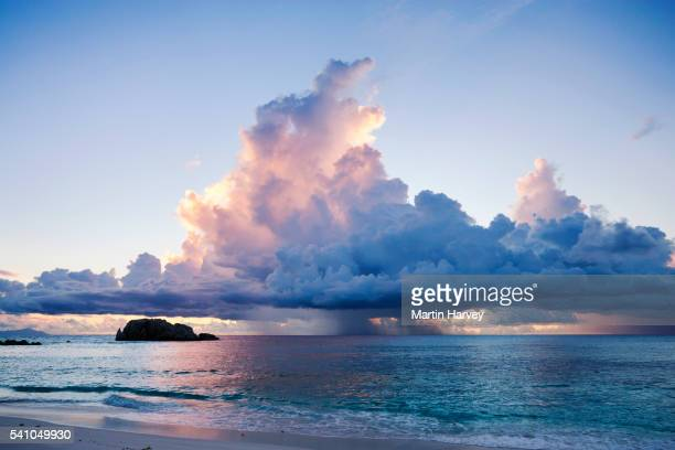 storm clouds at sunset over the ocean. seychelles. - paesaggio marino foto e immagini stock