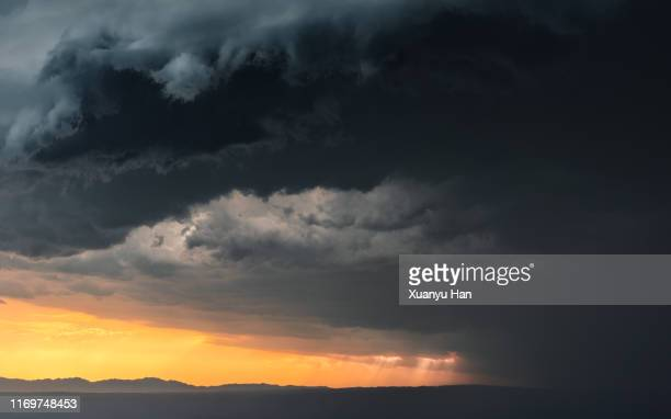 storm clouds at sunset - ostasien stock-fotos und bilder