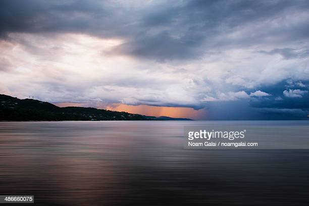 storm clouds at sunset time - noam galai stock pictures, royalty-free photos & images