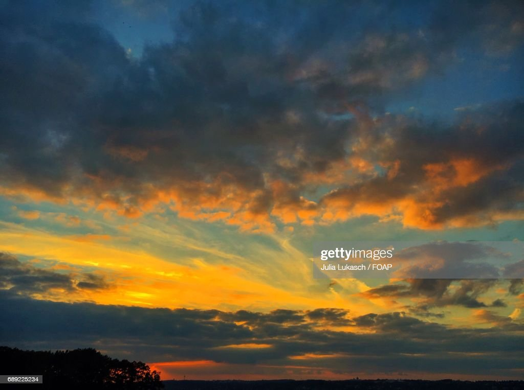 Storm clouds during sunset : Stock Photo