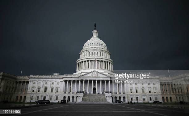 Storm clouds fill the sky over the U.S. Capitol Building, June 13, 2013 in Washington, DC. Potentially damaging storms are forecasted to hit parts of...