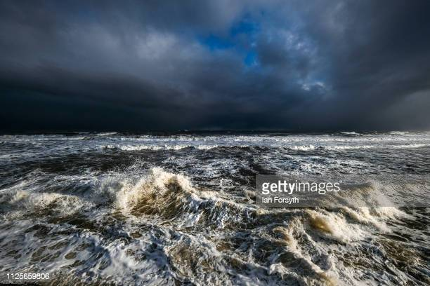 Storm clouds form over the North Sea off the North Yorkshire coast at Sandsend near Whitby on January 28 2019 in Whitby England Wintery showers and...