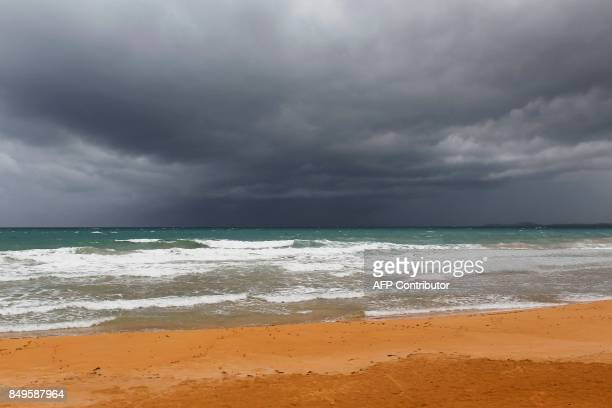 Storm clouds forms as Hurricane Maria approaches the island in Luquillo Puerto Rico on September 19 2017 Maria headed towards the Virgin Islands and...