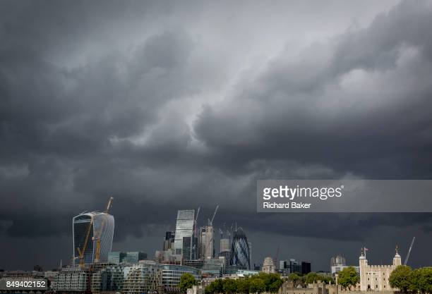 Storm clouds gather and dark times are ahead for the modern City of London on 14th September 2017 in London England The City is the historical...