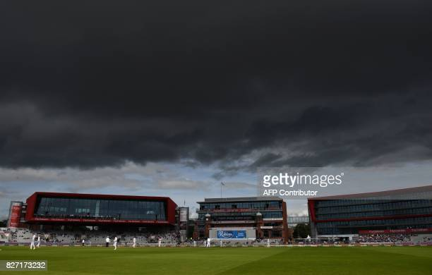 Storm clouds gather as play continues on day 4 of the fourth Test match between England and South Africa at Old Trafford cricket ground in Manchester...
