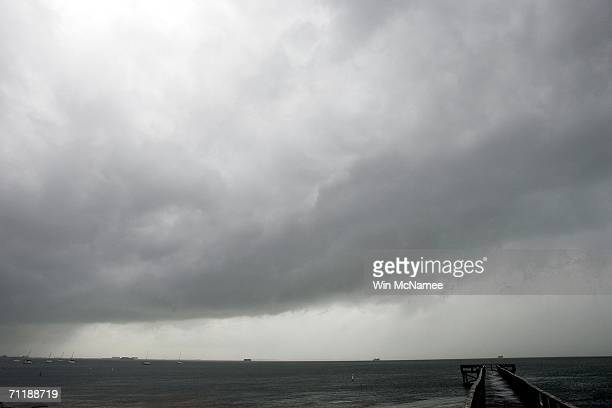 Storm clouds gather as Tropical Storm Alberto approaches the coast June 12 2006 in Dunedin Florida A hurricane warning was issued by forecasters as...
