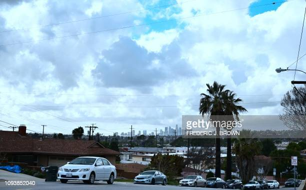 Storm clouds gather over Los Angeles during a break in rain on February 4, 2019 in Los Angles. - Storm showers are expected to continue over the next...