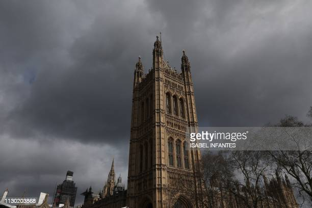 Storm clouds gather over Westminster Abbey in London on March 13 2019